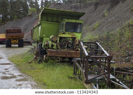 old rusty truck in junk yard - stock photo