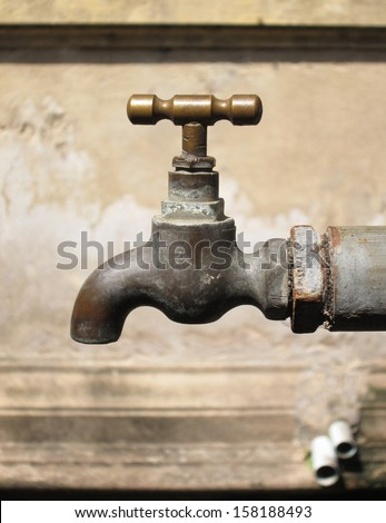 Old rusty water taps - stock photo