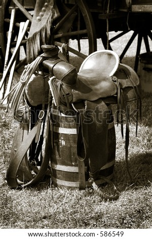 Old saddle in camp. - stock photo