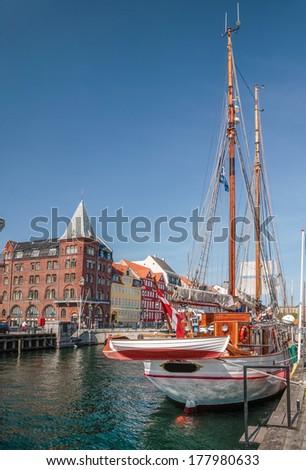 Old sailing ships and houses in Nyhavn in Copenhagen, Denmark - stock photo