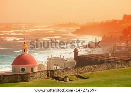Old San Juan ocean view with buildings in red tone - stock photo
