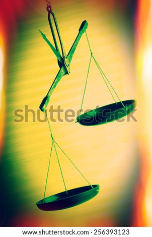 old scales of justice on green background with clipping path - stock photo