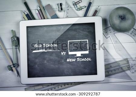 old school vs new school against blue chalkboard - stock photo