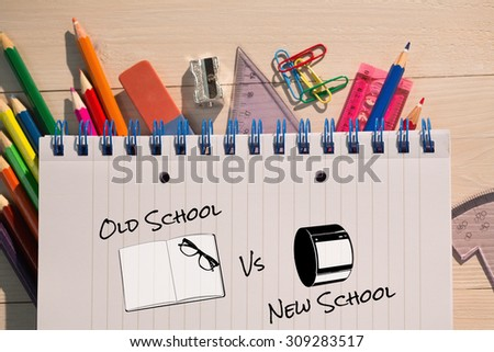 old school vs new school against students table with school supplies - stock photo