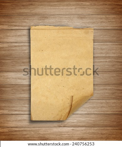 Old scrap paper on wooden wall - stock photo