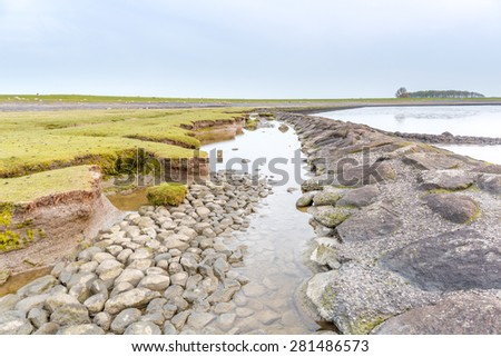 Old sea dike in the north of Holland - stock photo