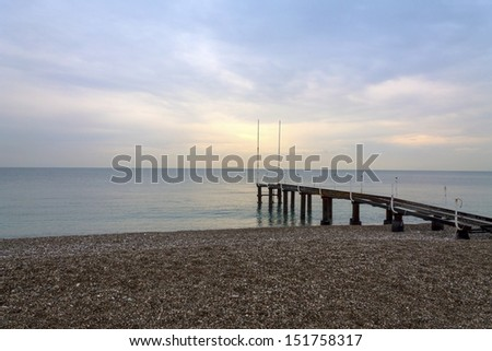 Old Sea Pier on cloudy day  - stock photo