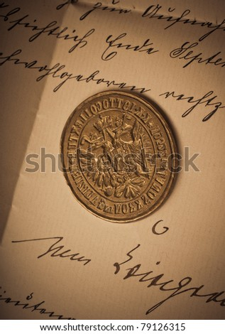 Old seal on a hand-written letter - stock photo