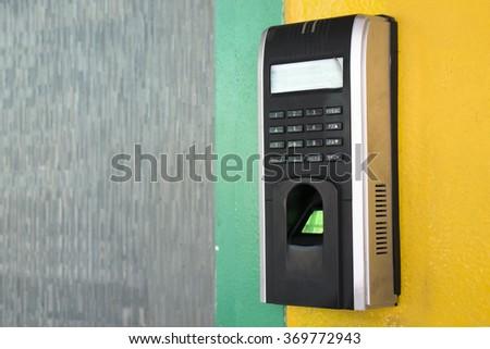 old security door keypad on wall - stock photo