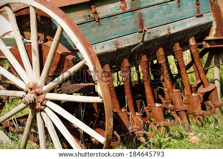 Old seeder. Agricultural machinery - stock photo