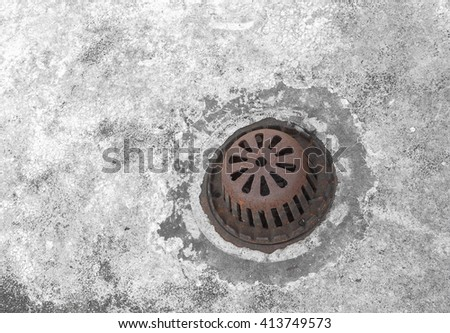 Old sewer grate drain water, The rust manhole cover. - stock photo