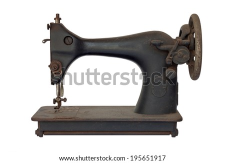 Old sewing machine isolated on white background - stock photo