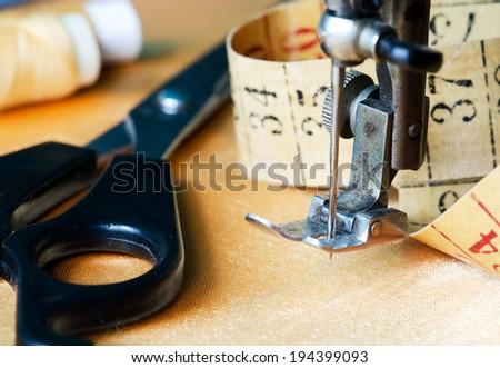 Old sewing machine needle.(Close up image.) - stock photo