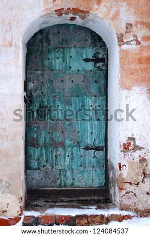 Old shabby entrance to one of the buildings in the medieval convent in Russia - stock photo
