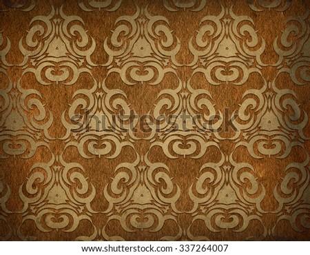 Old shabby golden wallpaper - stock photo