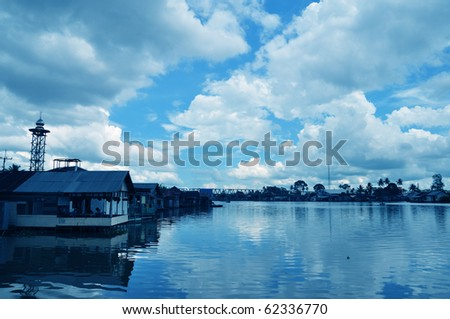Old shacks in Indonesia built on the rivers and waterways. - stock photo