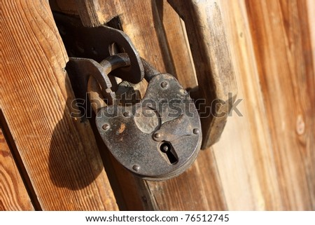 Old shed padlock - stock photo