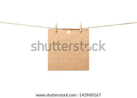 Old sheet of paper hanging on rope isolated on white - stock photo