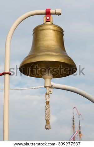 Old ship bell against a cloudy sky. Photo taken on: August 21, 2015. - stock photo