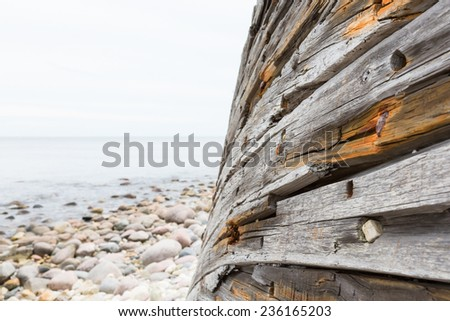 Old shipwreck on a seashore - stock photo
