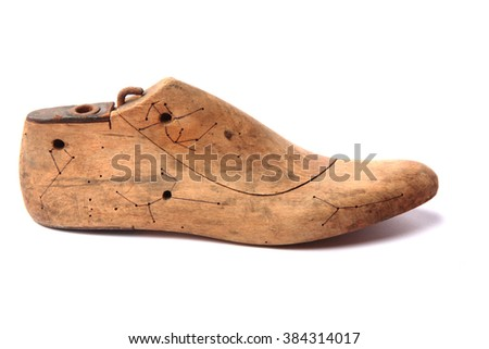 old shoe form isolated on the white background - stock photo