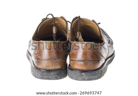 Old shoes. Isolated on the white background. - stock photo