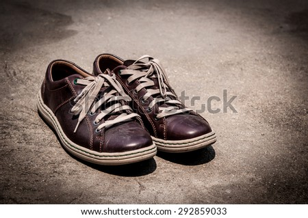old shoes sport on street - stock photo