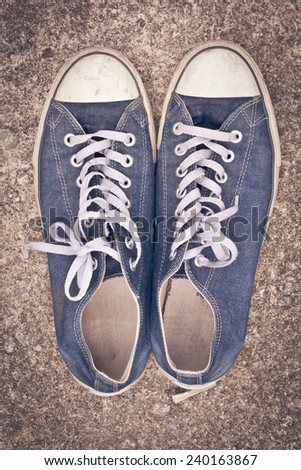 old shoes sport on street, process color - stock photo