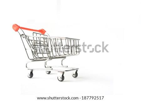 Old shopping cart on white background - stock photo