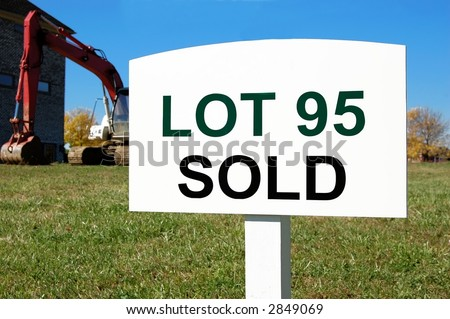 old sign on a residential lot in a new development - stock photo