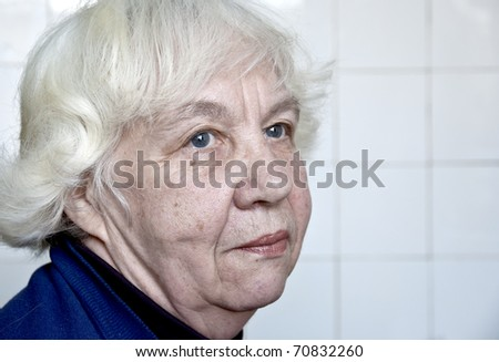 Old silver-haired woman. - stock photo