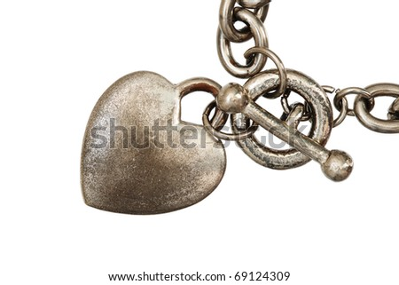 old silver heart charm on a chain isolated on white background - stock photo