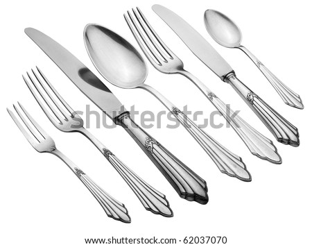 Old Silverware Set (Clipping Path) This set is old, it is not brand new, the flaws in the silverware are natural. This set has often served. - stock photo