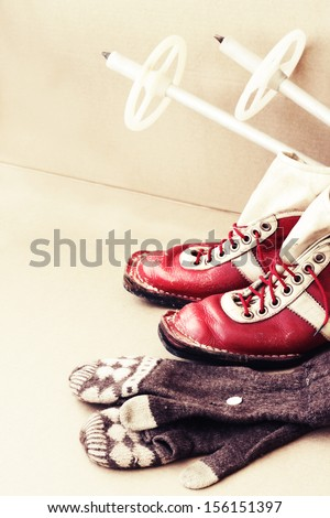Old ski equipment / Ski shoes and mittens in vintage style / Old Soviet ski boots - stock photo