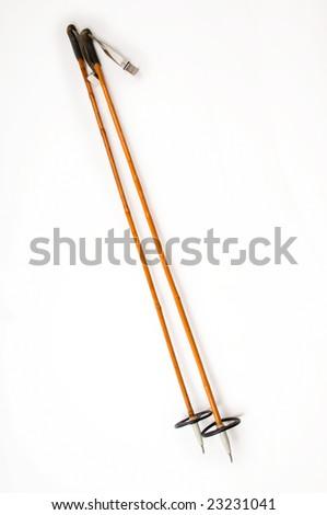 Old Ski Poles with White Background - stock photo