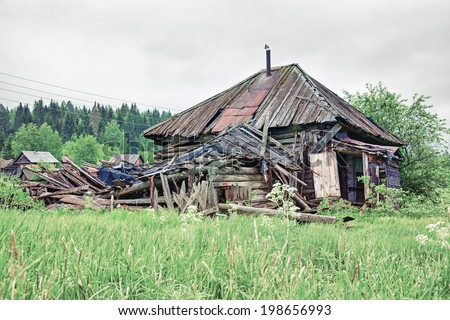 Old small abandoned and ruinous country house in Russia - stock photo