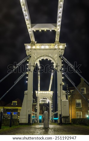 Old small drawbridge over the canal at night with cloudy sky, Enkhuizen, Holland - stock photo