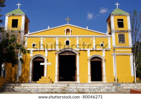 Old small yellow church on the island Ometepe, lake Nicaragua - stock photo