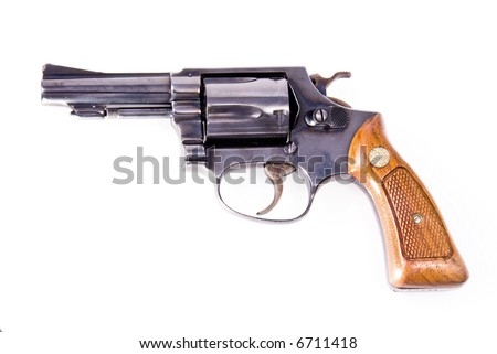 Old Smith and Wesson pistol with wooden handle - stock photo