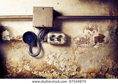 Old sockets on a grunge wall - stock photo