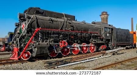 Old soviet freight steam locomotive series LV in railway station. - stock photo