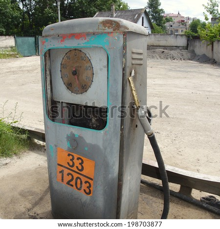Old soviet petrol station side view - stock photo