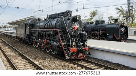 Old soviet steam locomotives series L and SO at railway station. - stock photo