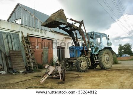 Old soviet tractor - stock photo