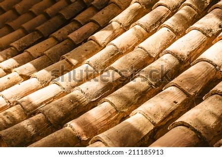 Old spanish, mediterranean roofing tiles. - stock photo