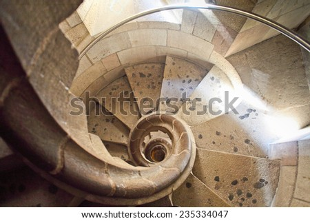 Old spiral staircase. - stock photo