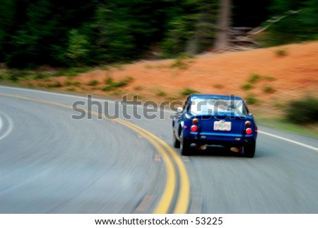 Old sportscar on a curvy road - stock photo