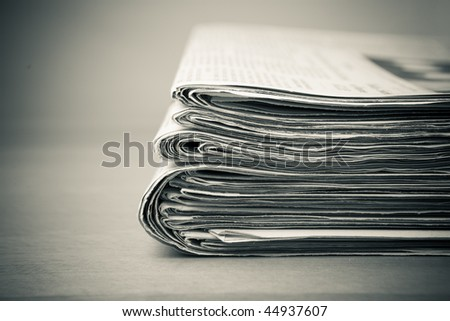 old stack of newspapers - stock photo