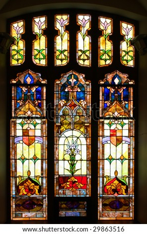 Old stained glass window in church - stock photo