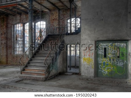 Old stairway next to an elevator in a deserted hall - stock photo